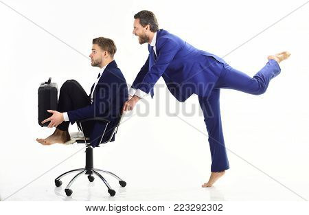 Business People Have Fun And Ride On Office Chair.