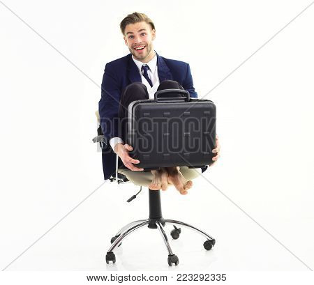 Office Worker With Silly Face Spinning In Chair.