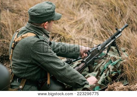Gomel, Belarus - November 26, 2017: German soldier Wehrmacht during the Second World War in the trench with a machine gun Czech production