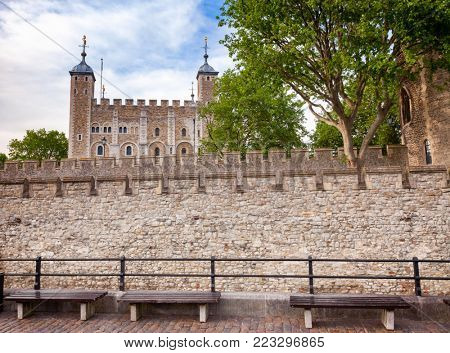 The outer curtain wall and the White Tower of the Tower of London  - historic castle and popular tourist attraction on the north bank of the River Thames in central London England UK