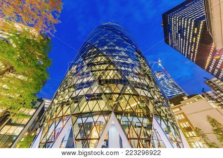 LONDON, UNITED KINGDOM - OCTOBER 26: This is a night view of St Mary Axe also known as the Gherkin, it is a skyscraper office building and famous landmark on October 26, 2017 in London