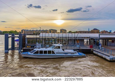 LONDON, UNITED KINGDOM - OCTOBER 07: This is a boat station in Canary Wharf people can use this station to cross to the other side of the river by a public transport boat on October 07, 2017 in London
