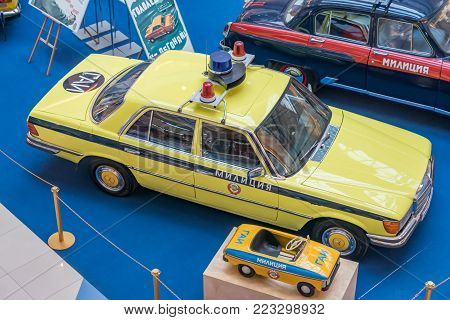 Moscow, Russia - November 23, 2017: Two Soviet Union police car, Merceds W123. Retro car exibition in Metropolis shopping mall