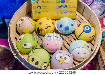 BANGKOK, THAILAND - AUGUST 16: These are known as Salapao in Thailand and have been made with cute animal faces, they have fillings in the center on August 16, 2017 in Bangkok