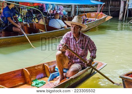 RATCHABURI, THAILAND - AUGUST 14: This is a tourboat in Damnoen Saduak floating market. Boats like this show people around the river area of the floating market on August 14, 2017 in Ratchaburi