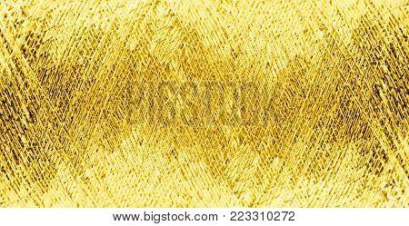 texture of golden metallic threads close-up