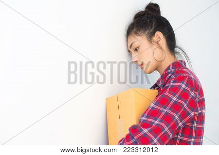 Asian woman holding box with stressful emotion. Young Owner Woman unsuccessful for Business Online, SME, Delivery Project. Woman with Online Business or SME Concept.