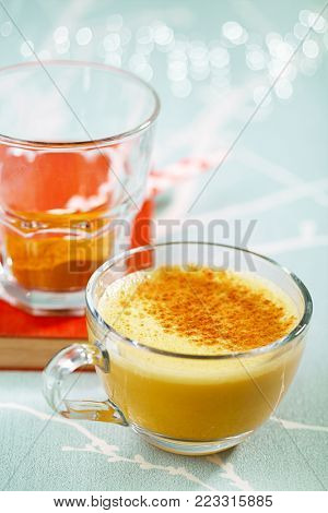 Turmeric latte or golden milk with spice mix, the drink is made by steaming milk with aromatic turmeric powder and spices