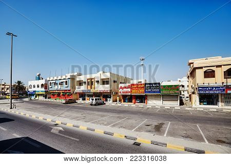 Sharjah, United Arab Emirates - May 03, 2017: Small shops in downtown Sharjah. The city is the third largest and third most populous one in the UAE.