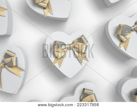 Heart shaped gift boxes with tied bows. Top view