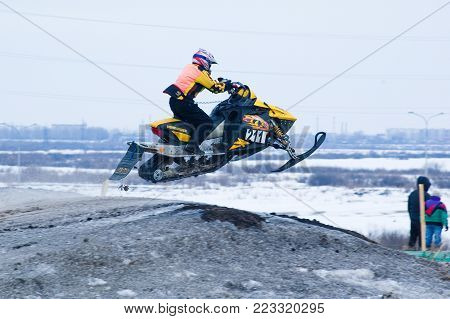 Tyumen, Russia - March 08. 2008: IV stage of personal-team Championship of Ural Federal district in over-snow cross-country. Sportsman jump on snowmobile