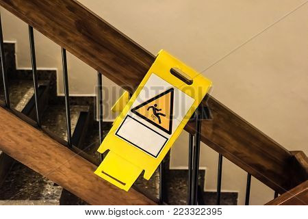 danger sign at a handrail in a staircase