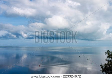 A sea like glass - The perfectly calm ocean mirrors the clouds in the sky