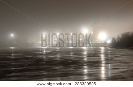 View of Neva River at night on the outskirts of St. Petersburg, Russia. Long exposure.