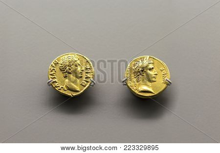 Merida, Spain - December 20th, 2017: Two golden coins of Augustus Emperor at National Museum of Roman Art in Merida, Spain