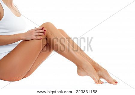 Long woman legs with smooth skin after depilation. Female hand touching perfect hairless soft and silky skin