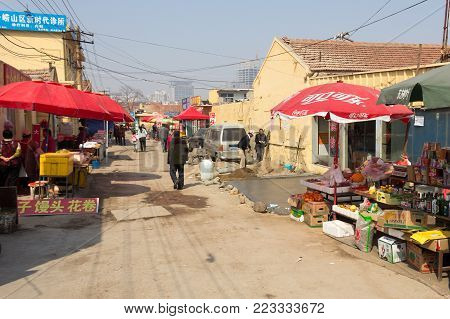 March 2014 - Qingdao, China - Daily life scene in the poor neighborhood of Shandongtou