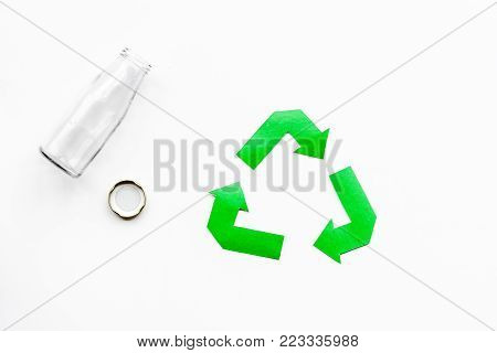 Sorting waste and recycle. Green paper recycling sign on white background top view.