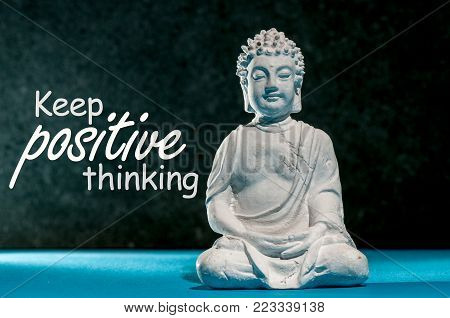 Keep Positive thinking - motivating message concept with Little Buddha statue. Think positive, be happy.