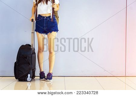 Departure lounge at the airport with woman's traveller and luggage.travel concept.