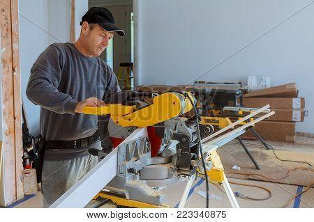 repair, building, construction, work, saw circular saw boards sticks flinders sawdust gloves hands people