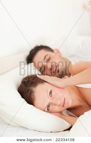 Woman not waking because of snoring in the bedroom