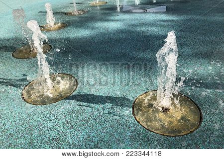 Outdoor playground with a set of decorative fountains and non-slippery rubber floor