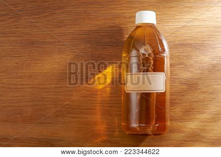 top view of apple cider vinegar on wooden background