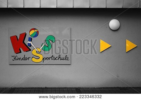 WEINHEIM, GERMANY - NOVEMBER 25: The colorful logo of the children's sports school Weinheim at the hall of the Hector Sports Center on November 25, 2017 in Weinheim.