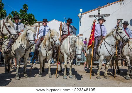Sent-Mari-de-la-Mer, Provence, France - May 25, 2015.  Square in the center of the city. Convoy on white horses before the start of the parade. World Festival of Gypsies
