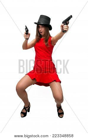 The spy. Special agent girl. Secret service. Dangerous sexy woman in red dress in stockings and high heels shoes is holding gun in her hands isolated on white.