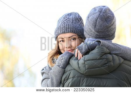 Young woman hugging her beloved boyfriend outdoors
