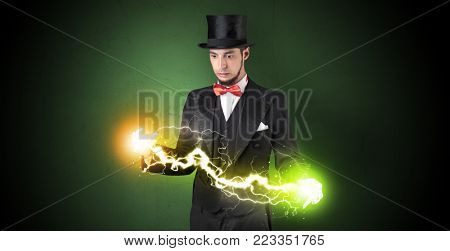 Magician sparkling super power between his two hands