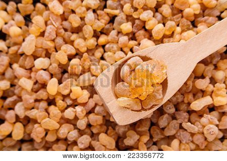 frankincense essential oil on a wooden background.
