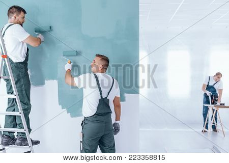 Painter With Gloves Painting Wall
