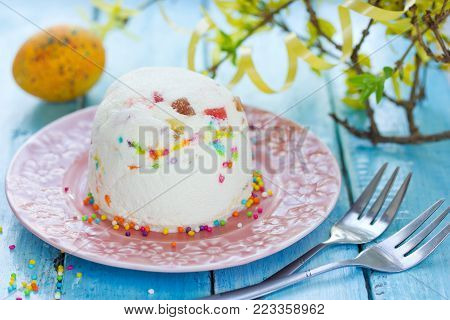 Easter quark dessert with candied fruit and colorful sugar sprinkling