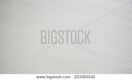 White leatherette texture for background and empty space for text.