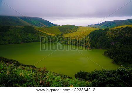 Panoramic view to Caldeira Funda lake at Flores island at Azores. Portugal