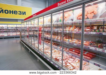 MYKOLAIV, UKRAINE - October 31, 2017: Cooling shelves with sausage products in hypermarket METRO