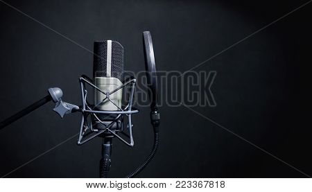 Professional Microphone in Recording Studio, Professional Studio Background with space for text