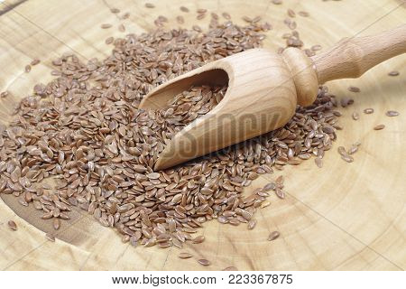 dry flax seeds with a wooden spoon