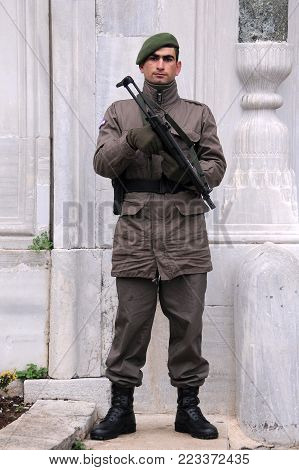 ISTANBUL, TURKEY - JANUARY 13, 2018: Military policeman armed with M5 submachinegun on duty next to Topkapi Palace