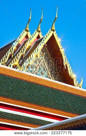 Detail of architecture at Famous Wat Arun (The Temple of  Dawn) temple in Bangkok, Thailand. The shelter of this temple is regarded as one of the most beautiful in Thailand.