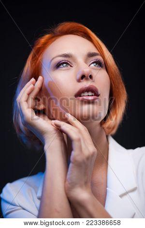 Closeup Fashion Woman Portrait. Vogue Style Model over black studio background