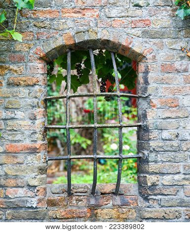 Medieval window with iron grating in Brugge