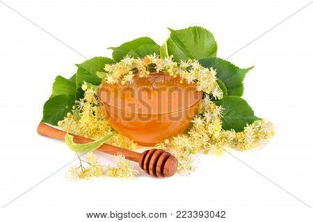 Fresh honey with linden flowers isilated on white background