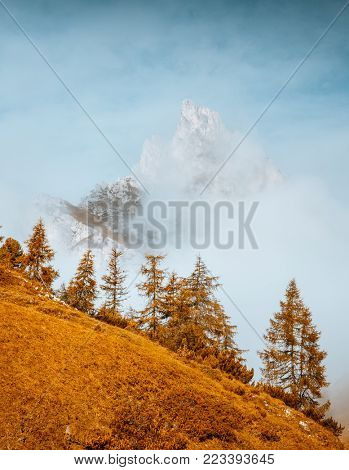 Attractive view of the foggy Mt. Sass de Stria from Falzarego pass. Location Cortina d'Ampezzo, Dolomiti, South Tyrol, Italy, Europe. Scenic image of hiking concept. Discover the beauty of earth.
