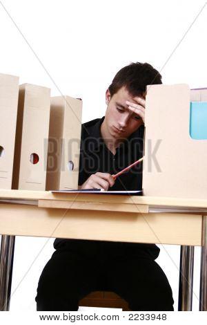 Male Businessman Sitting In Work