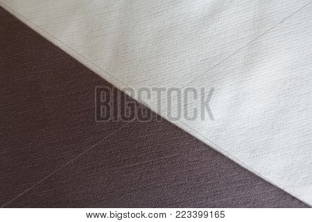 White and brown fabrics sewn together diagonally