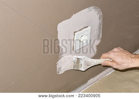 Do it yourself - renovating home. Working with brush. Working with different tools.